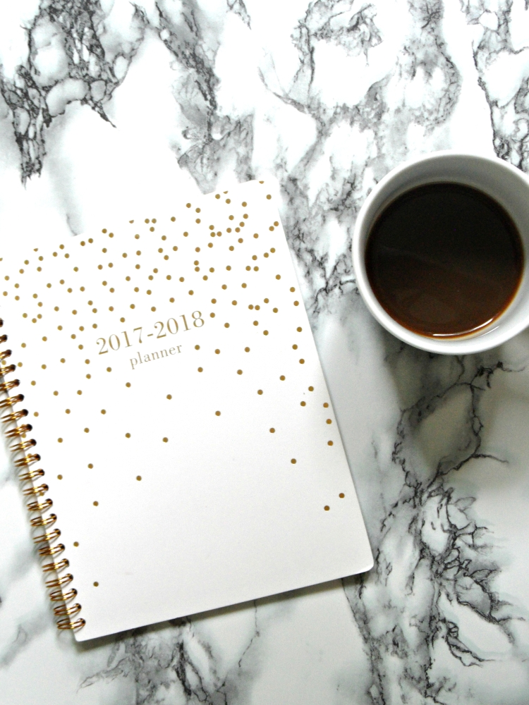 a planner and a cup of coffee