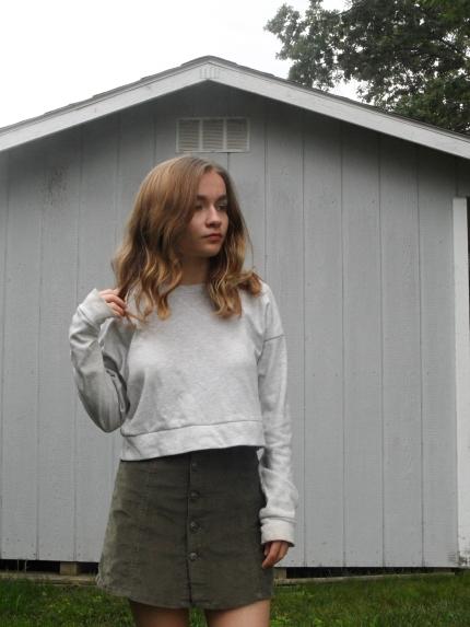 fashion blogger wearing corduroy skirt
