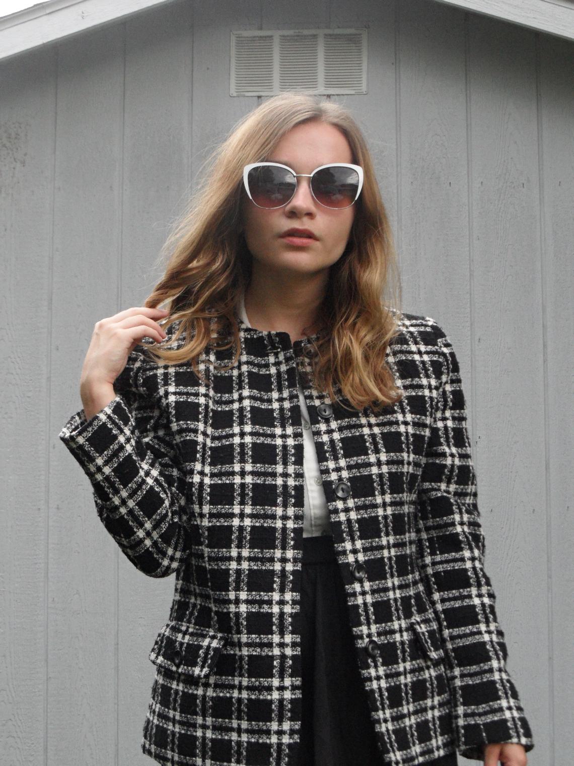 fashion blogger twisting piece of hair