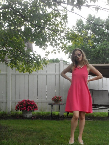 fashion blogger wearing pink dress and heels