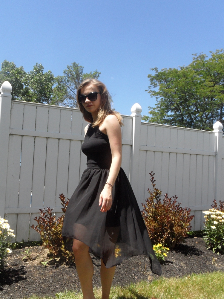 fashionable black skirt and sunglasses