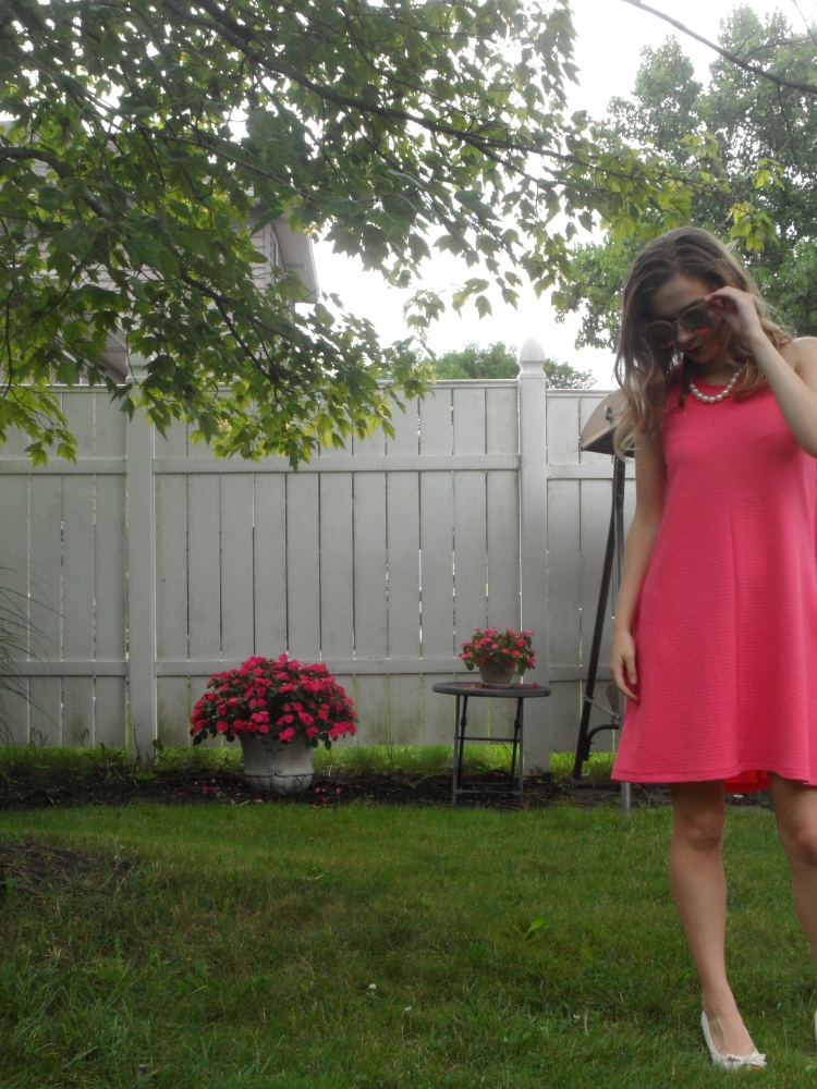 fashion blogger wearing pink dress
