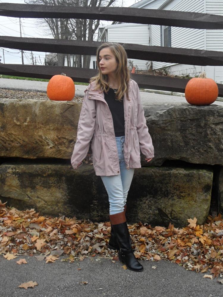 girl wearing purple raincoat
