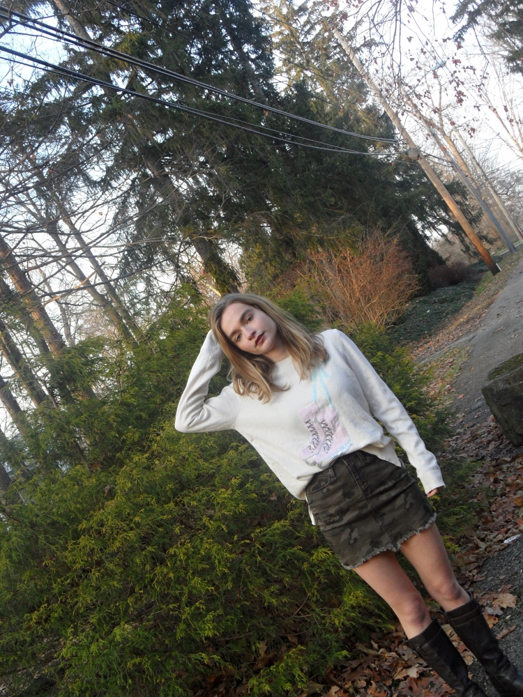 fashion blogger wears camo skirt and sweater