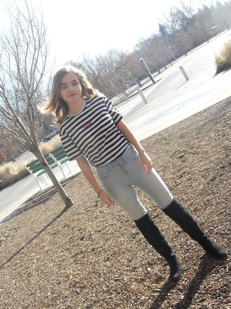 fashion blogger wears striped shirt and boots