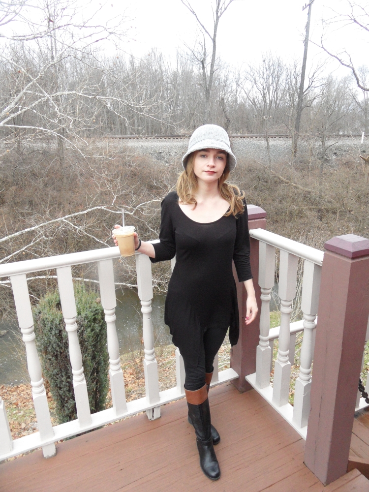fashion blogger wears hat and dress
