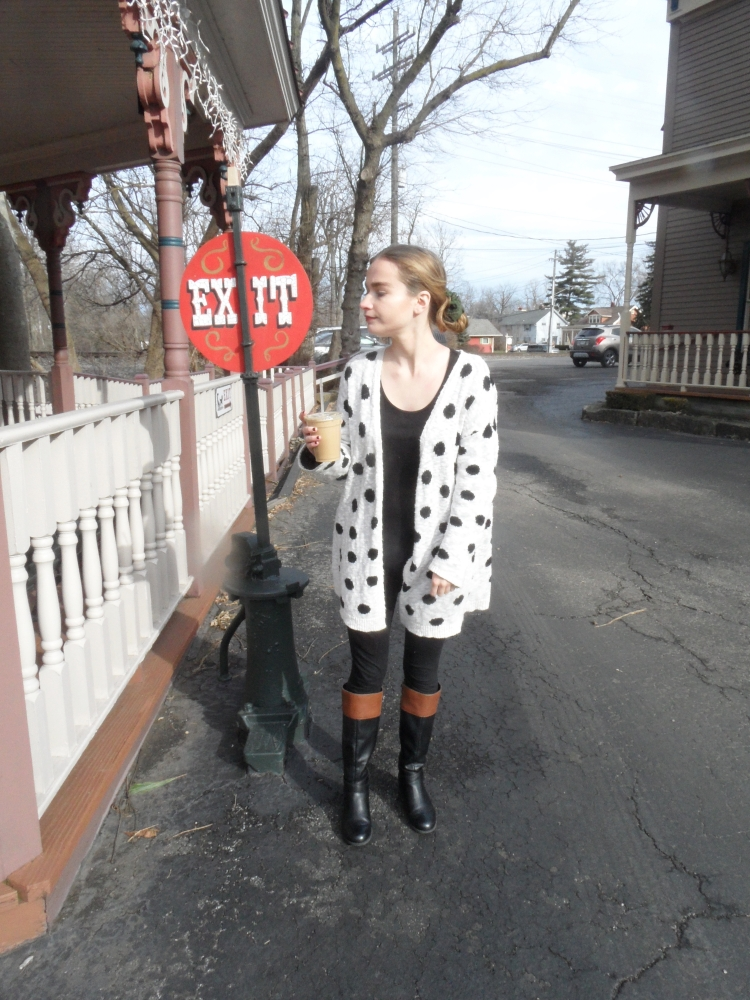 fashion blogger wears polka dot sweater, drinks coffee