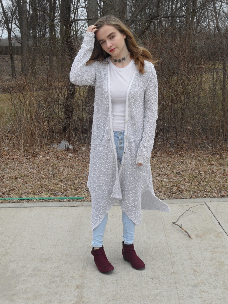 fashion blogger wears long gray sweater