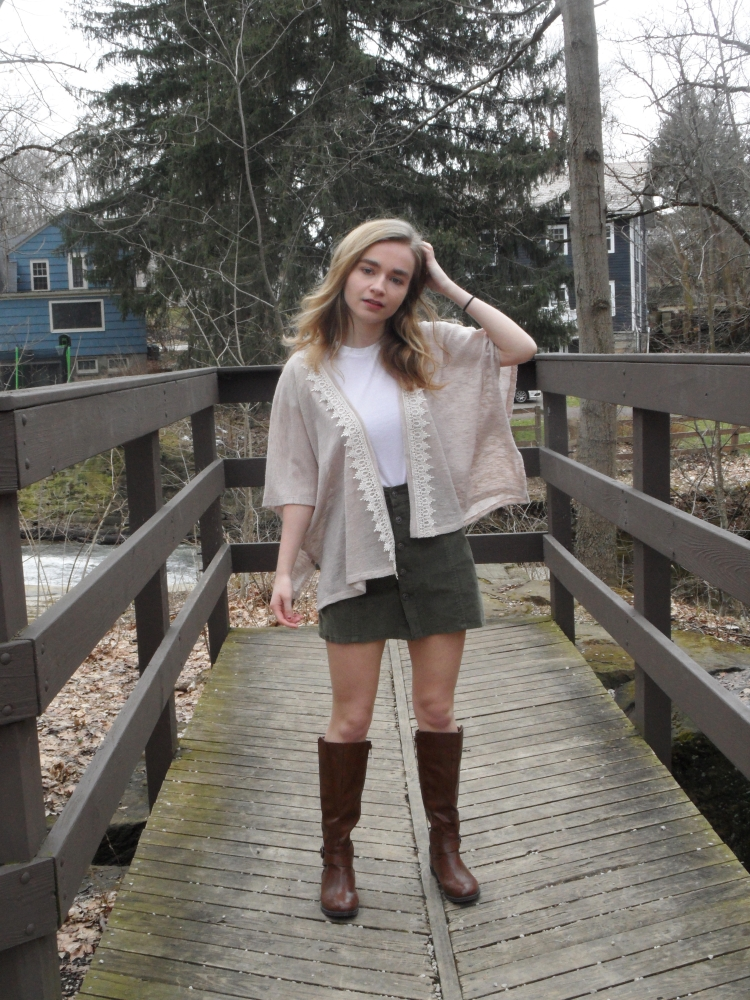 fashion blogger wears skirt and boots
