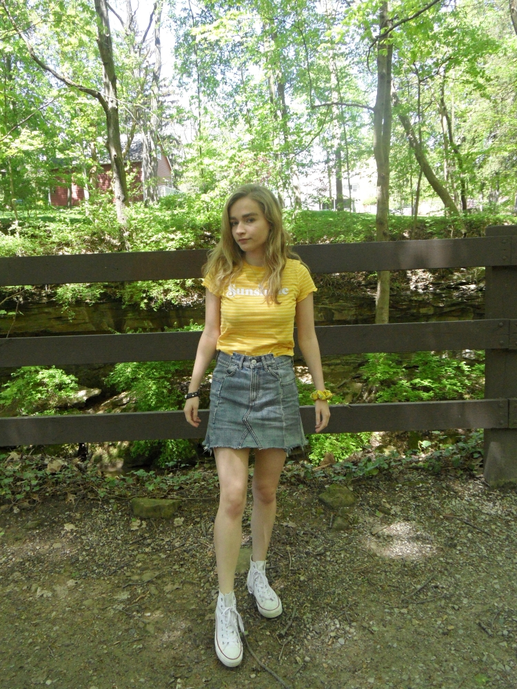 fashion blogger wears jean skirt, yellow top