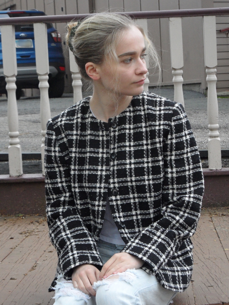 fashion blogger wears plaid blazer, black heels